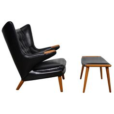 Hans Wegner Papa Bear Chair and Ottoman in Black Leather | From a unique collection of antique and modern lounge chairs at https://www.1stdibs.com/furniture/seating/lounge-chairs/