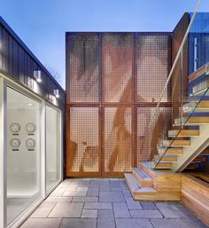 Mount Pleasant House by Roundabout Studio,Toronto, Canada - perforated, back-lit corten steel panels in the courtyard Metal Siding, Metal Screen, Metal Fence, Perforated Metal, Steel Panels, Mount Pleasant, Bulb Flowers, Metal Buildings, Architecture Design