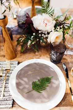 personalized porcelain plate DIY / photo by Cambria Grace, styling by Lauren Wells http://ruffledblog.com/winter-bridal-shower-ideas #diy #diyprojects #favors
