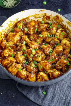 A large pan filled with prepared sticky sesame cauliflower. Topped with green onions and sesame seeds. Vegan Dinner Recipes, Vegan Dinners, Veggie Recipes, Whole Food Recipes, Cooking Recipes, Healthy Recipes, Easy Cooking, Cooking Fish, Noodle Recipes