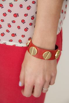 This ultra soft and stylish vegan leather bracelet with gold circle details are a great way to not only color block but also accessorize your arm party with.  $24.25