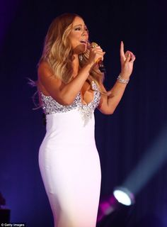 Touch my body: The 45-year-old's tight gown showcased her stunning hourglass figure and am...