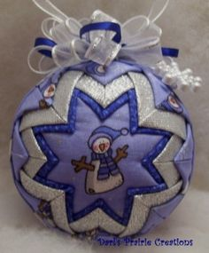 I think these quilted ball ornaments are so pretty!!!!  Note to self - find a tute, (unless you wanna make it :D_)