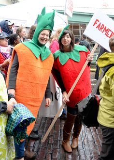 Pike Place Market farmers celebrating in fun costumes at the Pike Up! Parade.