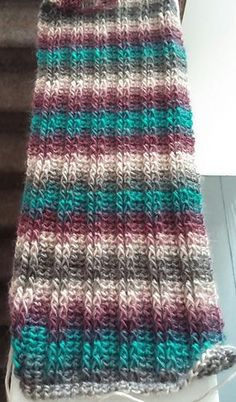 Style your outfit with a beautiful crochet scarf this winter. Saw this scarf done in Tealberry and I loved it! It's a beautiful colorway and a good looking stitch. This Simply Unforgettable Scarf by Elizabeth Harper (Tattoo Betty's House of Hookin') is in Tunisian Crochet, Crochet Shawl, Crochet Stitches, Chunky Crochet Scarf, Crochet Cardigan, Crochet Granny, Caron Cake Crochet Patterns, Knitting Patterns, Poncho Patterns