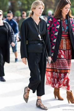 Sarah Rutson in a perfectly elegant and relaxed black trousers and blouse pairing. I love the wrap effect and the belt on the shirt and the stand-out necklace.