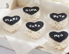 So swwweeeeet! Heart shaped with chalkboard lid favor holders in classy black and white! Order a lot, save a lot! http://www.firstavenueweddingfavors.com/diy-chalk-heart-labels-heart-favor-holder-set-of-12/