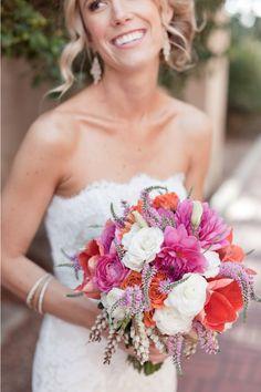 Pink and orange wedding bouquet. Wedding Photo || Colin Cowie Weddings