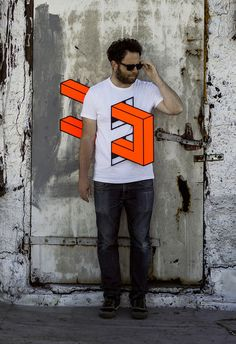 In his series Landline, New York-based artist Aakash Nihalani cleverly pierces human torsos throughout Brooklyn with three-dimensional isometric rectangles and squares made out of neon tape. The artist's keen eye for perspective is evident in the optical illusions, which are produced with tape, paper, corrugated plastic, and magnets