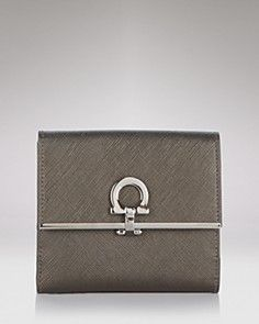 Trifold wallet in textured leather with signature lock detail from Salvatore Ferragamo #bags #handbags