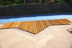 Custom Great Northern® Roll-Up® Cover created for a pool side hot tub. Hot Tub Cover, Western Red Cedar, Garden Bridge, Spa, Outdoor Structures, Hot Tubs, Traditional, Building