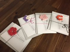 Beautiful  flower greeting card with blank inside. Hand crocheted by one of our wonderful refugee women Comes with envelope. Each pack comes with 5 blank cards of various colors. All profits go to the artist to better her new life here in the states.