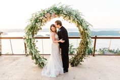 Full Floral Moon Arch - PropHouse Birmingham Wedding Planner: M.Elizabeth Events Venue: Lake Guntersville State Park Photography: Alisha Crossley Photography