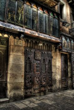 Galerias Sant Jordi, Barri Gotic, BARCELONA. I would LOVE to know the history of these doors!