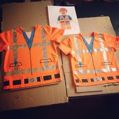 DIY Lego Movie Emmet Shirts! Orange shirts painted with Tulip Soft fabric paint. I used masking tape to mark the lines, and a black fabric marker to draw in the details. Ready to wear on our trip to #Legoland! #legomovie