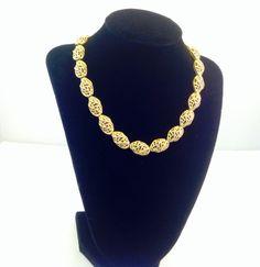 Gold Tone Demi Parure Oval Filigree Vintage necklace Signed Trifari https://www.etsy.com/listing/203674256/good-tone-demi-parure-oval-filigree