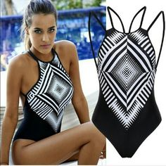 """Geometric Strappy One-Piece Black and White Geo Pattern, Criss Cross straps in back. Padding. Reposhing this. Unfortunately didn't fit. I have a long torso and DDD so it would be perfect for a smaller cup. 14"""" across the padding. Swim One Pieces"""