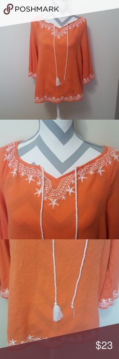 Crown & Ivy Beach Orange Shell Starfish Top Crown and Ivy brand in a size Medium. It is from the beach line and is a vibrant Orange color with white embroidery. It has cute starfish designs and a tie tassel. I believe I only wore it once so there are no stains or holes. However, one of the tassels did come off but if you tie them you can't tell. Smoke free home and fast shipping. I do offer bundles deals as well. Thank you for checking out my closet. Crown & Ivy Tops