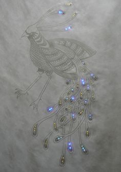 conductive ink screen print, surface mount LED lights, conductive thread, wires, power supply on Tyvek