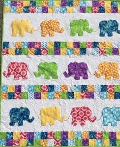Elephants on Parade Baby Quilt from http://www.HomeSewnByCarolyn.com