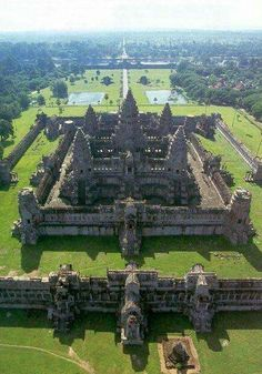 That's Angkor Wat in Cambodia. It was built during the second half of the 12th century and dedicated to the god Vishnu. It's the largest religious temple in the world.  Toward the end of the 12th century, Angkor Wat gradually transformed from a Hindu center of worship to a Buddhist temple, which continues to the present