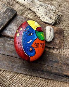 Ganesha, the god of new beginnings...#hope #paintedrocks #indiangod #artonrocks…