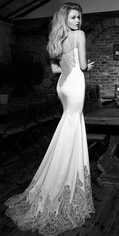 Backless wedding dress.     Lace as sheer hem, awesome