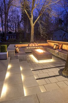 Highlight your terrace with subtle lights that can help transition the party from day to night. Techo-Bloc products shown: Raffinato fire pit and walls in Smooth Greyed Nickel and Blu slabs in Smooth Greyed Nickel.