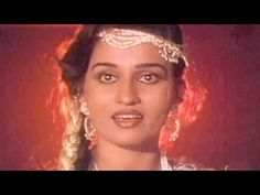 """Disco Station Disco - Reena Roy, Asha Bhosle, """"Let go, of my arms, of my path"""" Chorus: """"These are handcuffs of love!"""" """"The train is here, but he is not, look at me all dressed! My large doe eyes scan the junction, oh woe, my eyes met with who? Handcuffs of love are on you! People, do not rescue me, let me  go thru the perils of love, hold me in your embrace, love me, but then it remember to let go!have to leave, handcuffed to  him,"""