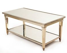 DEUX PLATEAU COCKTAIL TABLE  Argente with antique mirror top and lower shelf.  Item: 2005