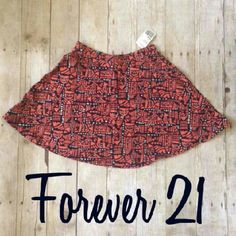 Forever 21 Coral and Navy Blue Skirt New with tags.  Size Small.  Color: Coral and Navy. Forever 21 Skirts