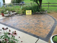 Small Relaxing Paver Patio by Water Garden Installed by Ryan's Landscaping. Patio shown in Nicolock Adobe Blend With Charcoal Border. Style Stone Ridge