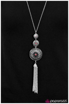Three silver plates increase in size as they cascade from the bottom of a long silver chain. Each plate is decorated with ornate textures and patterns and accented by one red rhinestone that adds just enough sparkle. A tassel of silver chain swings from the lower disc, bringing dramatic length to the design. Features an adjustable clasp closure. .... $5  Sold as one individual necklace. Includes one pair of matching earrings.