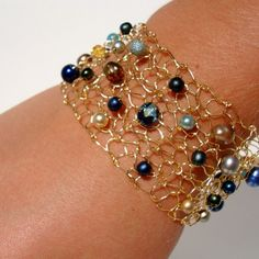 peacock colored wire mesh cuff.