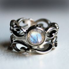 Moonstone engagement ring set - rainbow moonstone - recycled sterling silver - swirl infinity - made to order- Wrought ring. $280.00, via Etsy.