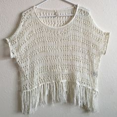 HOST PICKBoho Crochet Fringe Top Another asymmetrical top! Crochet style with fringe hem!! Very soft and lightweight great for layering!! Beautiful ivory color!! Lapis Tops