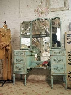 I've been looking everywhere for a vintage vanity EXACTLY like this! Only color wise, I was thinking more ivory with gold accents. I wish I'd found it before it sold.. sigh