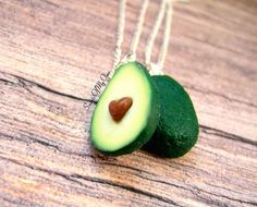 This listing is for x1 Set of Avacado Halves Best Friend Necklaces. The Avocado Stone is in a Heart Shape. You will receive the two halves, one with the Avocado Heart Seed in the middle and one half without it. - This is a Handmade item. - Each Avocado half is roughly 2cm tall (0.8