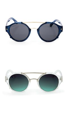 Retro-inspired sunglasses with a rounded shape and metal bar detailing along the bridge