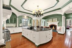 Traditional Kitchen with Columns, Undermount sink, Ms International Green Eyes Granite, Limestone Tile, Crown molding, Flush