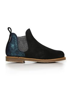 One of Penelope Chilvers' bestselling silhouettes, this rework of the classic Patchwork Safari boots offers a playful mix of rich black Spanish suede, metallic turquoise heel panels and glittering silver elasticated side panels. The Patchwork Safari boots are also equipped with a Goodyear welted crepe sole for supreme comfort and robust longevity.