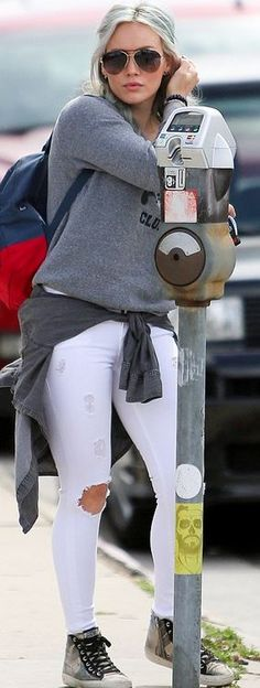 Who made  Hillary Duff's gray sweatshirt, white ripped skinny jeans, and print sneakers?