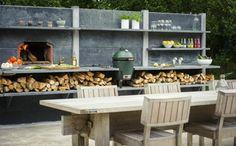 cuisine d'été à l'extérieur aménagée sur mur dalles béton