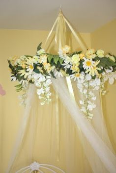 DIY bed canopy for little girls room - use embroidery hoop and either tulle or cheap sheer curtains from IKEA - feather boa instead of flowers