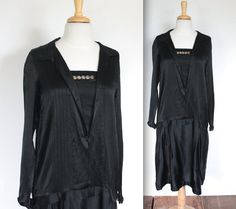 SALE! Was $400 Now $295    Stunning vintage 1920s black silk chiffon flapper dress with metallic rosettes at collar base! This dress has a drop
