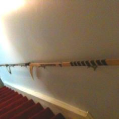My Husband came up with a brilliant use for old hockey sticks- our new railing for the basement 'man cave'