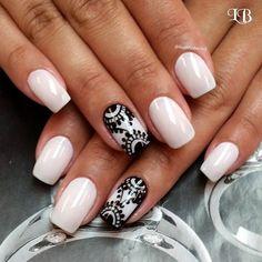 Elegant Black Lace on White Nails