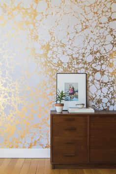 Calico Wallpaper offers a touch of metallic gold inspiration to a space. | ICFF
