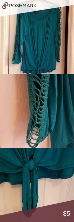 ABC Studio top size xl Teal long sleeve ties at the bottom front. Sleeves have a crochet pattern all the way down . 95%rayon with 5% spandex.worn once. AB Studio Tops Blouses