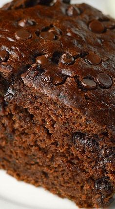 Double chocolate zucchini cake is lightened up using half the oil. Super moist and chocolatey! Just Desserts, Dessert Recipes, Keto Desserts, Party Recipes, Fig Cake, Mini Chocolate Chips, Zuchinni Chocolate Cake, Double Chocolate Chip Cake Recipe, Chocolate Sweets